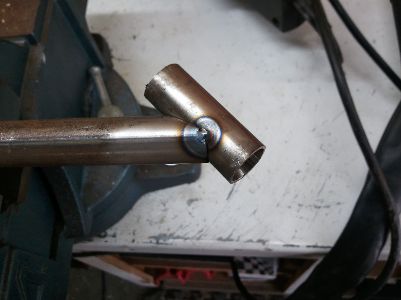 Tacked on both sides, then remove clamp to position for welding