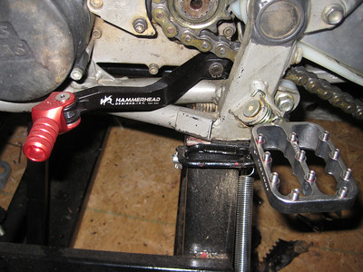 Hammerhead shifter and Fastway pegs replace the OE parts.