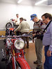 Bill, Griff, Jim and John look at bikes.