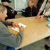 Soup stop at the Phil's home. Jeff gives out cards for the Poker Run. Jeff, Chris, Fielding and Dave holding cards.