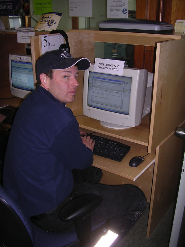 Jackhole gets his free internet on in the library at Churchill Falls, Labrador.