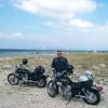 Adam with bikes in front of the Mackinac bridge
