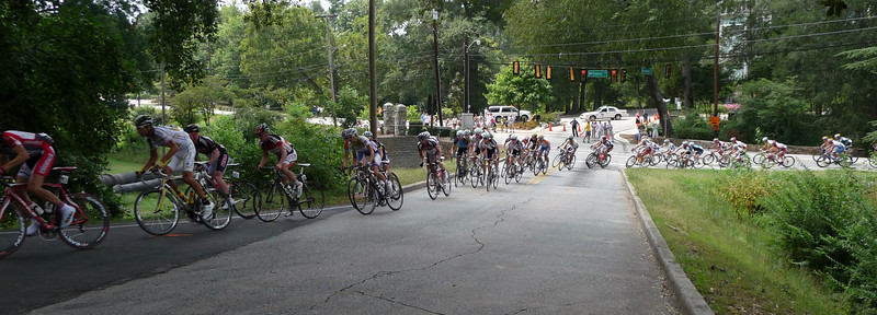 Riders at tight S turns entering the park on the first lap.  George Hincapie in white at left of frame
