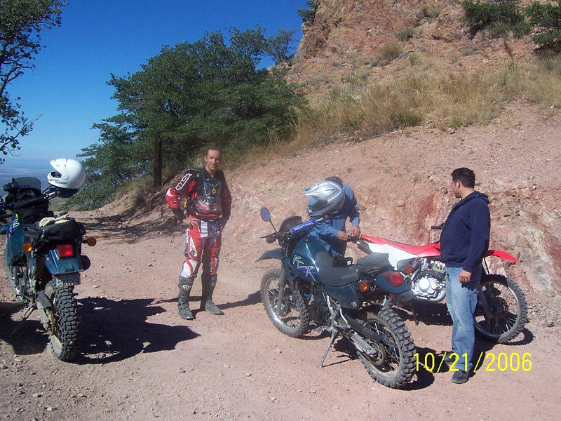 Craig and I took an afternoon to make a quick ride up to Gunsight Pass.  The weather was nice and we were surprised to find the roads up from Rosemont Junction had been graded to the point that a Honda Civic could make it (with minor body damage).  The view at the top was as spectacular as ever.  Some folks with quads were there when we arrived and shortly after they left two bikers came up from the other side.  They were both on 250s. One had a KLR and the other had a Honda.  The guy with the Honda is inspecting his blinker that was burned off by his exhaust.