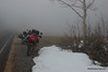 The fog lifts a little and we find snow.  10,000+ feet (3050+ meters)