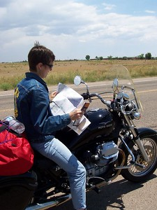 Caroline has to check the map along Hwy 14 (the Turquoise Trail) in New Mexico.