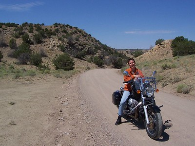 Caroline takes a break after a mile of gravel road in Cerillos, NM.