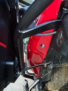Left side mounting points: rear bolt of the passenger footpegs, the rear lift handle bolt, and the bolts that secure the rear fender and license plate holder.
