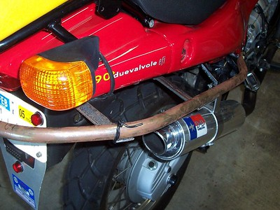 """The main support for the home-made Givi mounting system is made from 3/4-inch mild steel tubing. It was bent into a squashed """"C"""" to fit under and around the tail of the bike. It almost perfectly follows the lower line of the tail."""