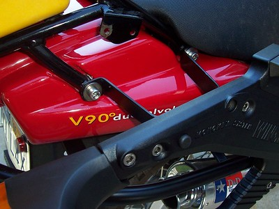 """Upper mounts are 1/8-inch steel bent into kind of a """"U"""" shaped bracket. They attach at the stock luggage rack bolts."""