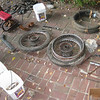 Original wheels and ominously, a set of NOS tires held together in twine with their british origin ship label intact.   Those later provided two eye opening blowouts to further my riding education.  Pile in upper left is variety of suspension pieces and spare shock absorbers.