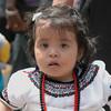 La niña es el orgullo de Papá.  Celebración del Día de la Virgen, patrona de Xela.