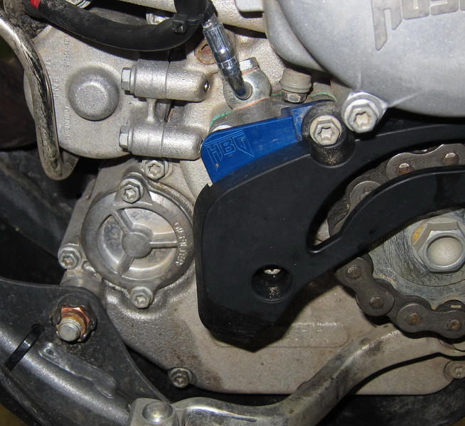 Husaberg Hard Parts brake cylinder and case guard protector, under the black plastic guard designed for it. Stock guard won't fit.