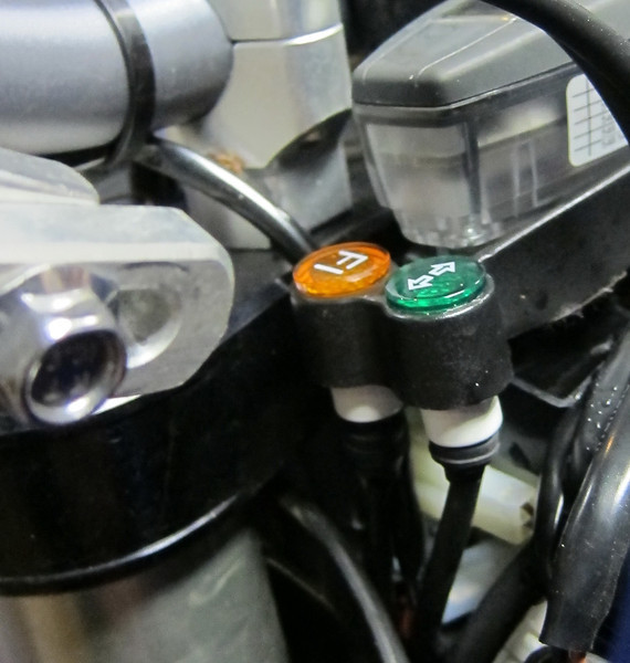Green turn signal indicator, not standard on dirtbike version and has to be added for dual-sport conversion. KTM Part# 580.11.024.300