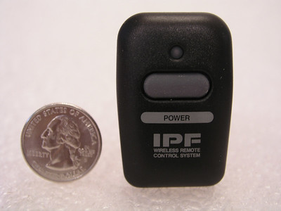 Wireless remote, with a quarter for comparative sizing