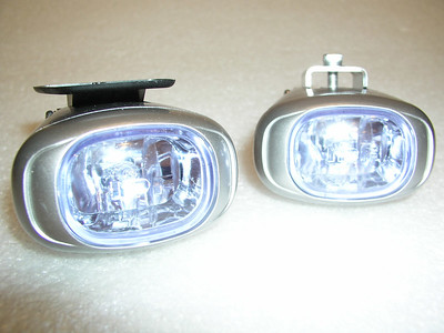 A view from the front, showing the compact lens and housing.  The lens can be reconfigured so the mounting plate is to the bottom.  The optional BestRest stainless steel mounting bracket is on the right lamp
