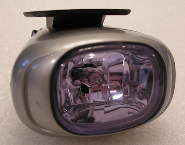 A view from the front, showing the compact lens and housing.  The lens can be reconfigured so the mounting plate is to the bottom.