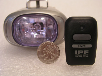 IPF REV1 light, wireless remote switch, and a quarter for comparative sizing