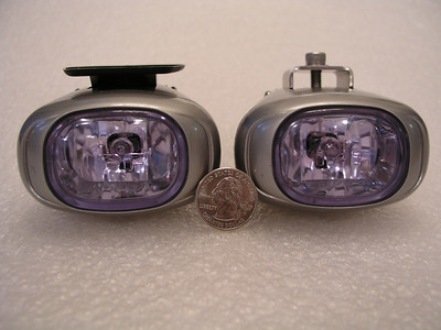IPF REV1 lights, with a quarter for comparative sizing.
