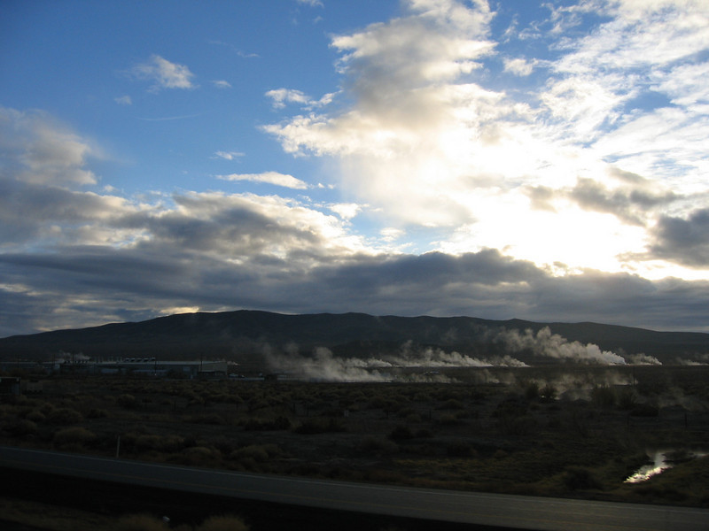The area near Reno and Carson City is geologically active, with hot springs and thermals.  In some locations, they tap the natural heat as a way of generating power.  Here you can see the steam vents from the natural hot springs.