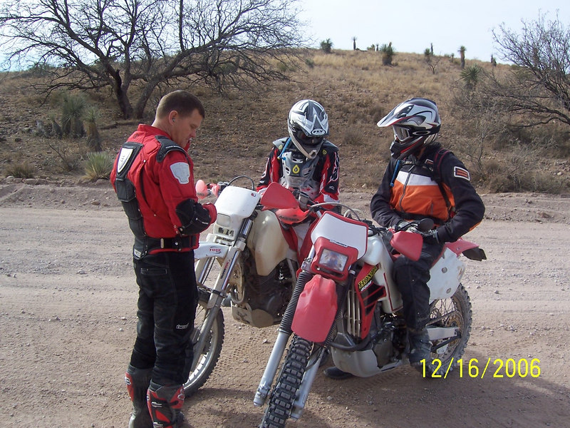 Jim, Craig, and Troy converse at the cut-off fork leading to Muleshoe Road.