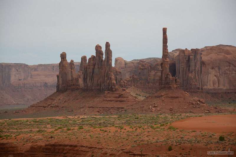 On the right is Totem Pole, climbed by Clint Eastwood in the movie, 'The Eiger Sanction'. Monument Valley, Arizona