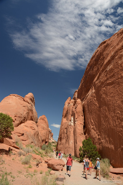 Hiking a mile to see some arches.
