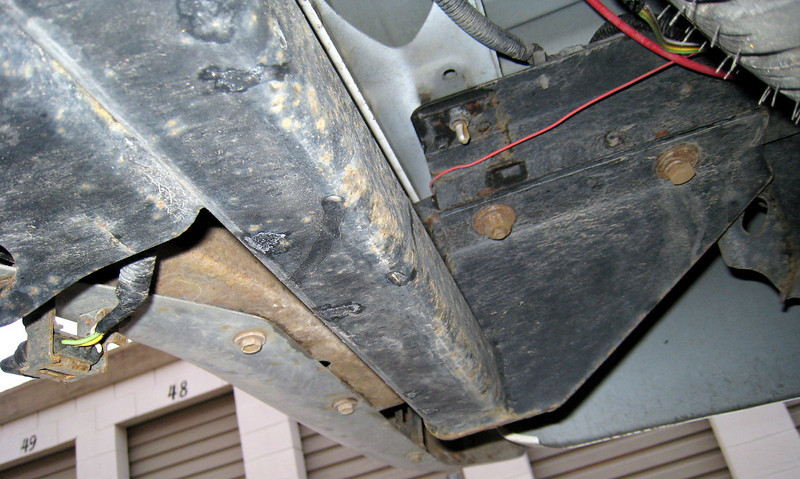 Underside of trailer hitch bolted to Toyota Tundra.