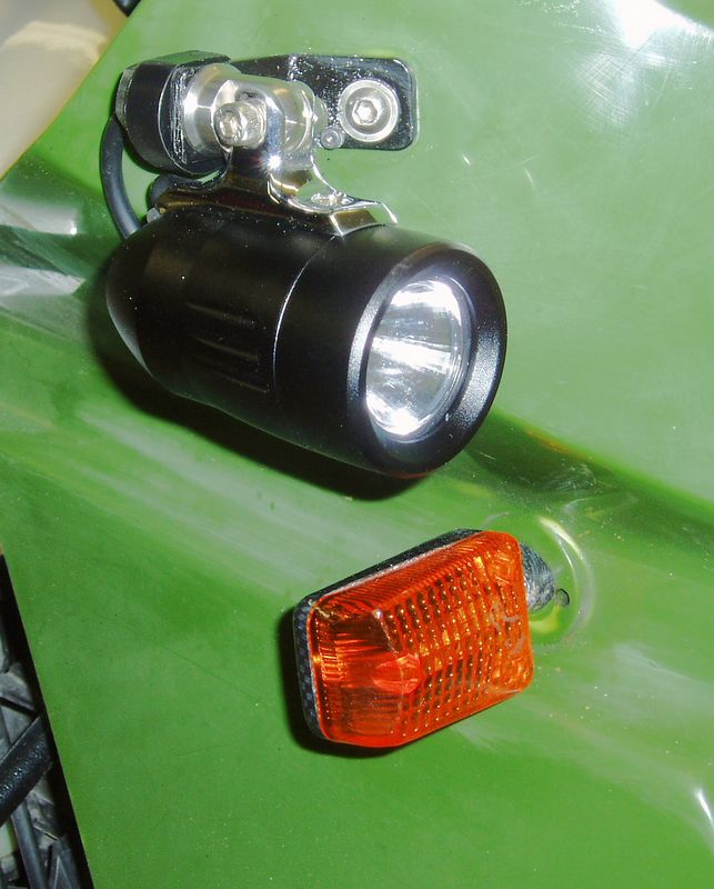 "This is my installation of Trail Tech's 13W auxiliary lights.  <a href=""http://www.trailtech.net/motorcycle_hid_parts.htm"">http://www.trailtech.net/motorcycle_hid_parts.htm</a>)<br /> The ballast is contained in the shell. There are only two wires to deal with. I did have to make a spacer because of the mounting stud length. Otherwise these fit right where my 35W Walmart lights were. I have a switch for these lights mounted on a mini-dash."