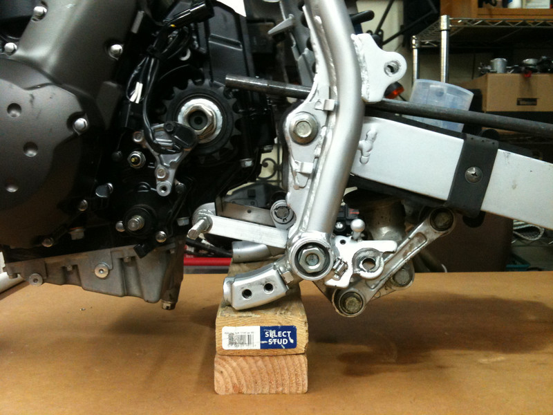 The position of the engine in the frame revolved around the drive sprocket.  Working on getting the chain alignment right.