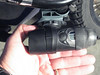 The round button just aft of the viewfinder is your menu button, the tiny triangle to the left is ON / OFF, while the right triangle is the Select button. How big is the camera? I dunno - how big is my hand?