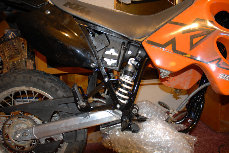 Rear brake connected and side covers installed
