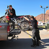 Jesse Ziegler (former writer at Dirt Rider mag, now with Klim USA) unloads my RXV from his truck after he picked me up after the crash out in the desert. Edward (of Klim USA) and Morgan (my event roommate) help unload. Both riders who were with me and went for help after I crashed.
