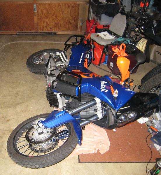 Installing a Rekluse zStart Pro auto-clutch in a 2007 KTM990S . First, remove skidplate then place the bike on it's side.