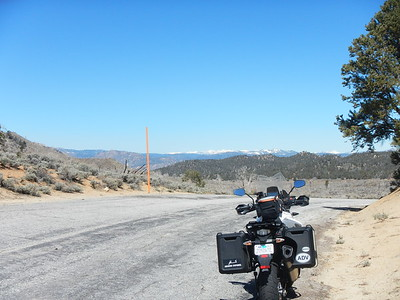 "At the ""pass"" going into Kennedy Meadows. Sierras off in the distance. There wasn't any snow last year."