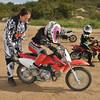 Elizabeth teaches Alana how to kick start the bike.