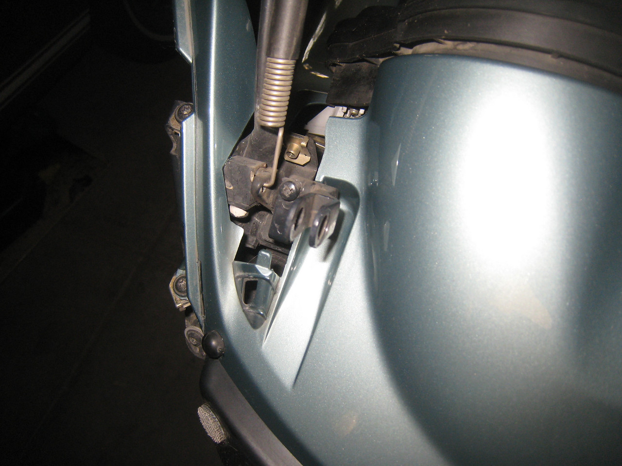 Before you can remove the cowl, the windscreen brackets must be rotated out of the way.