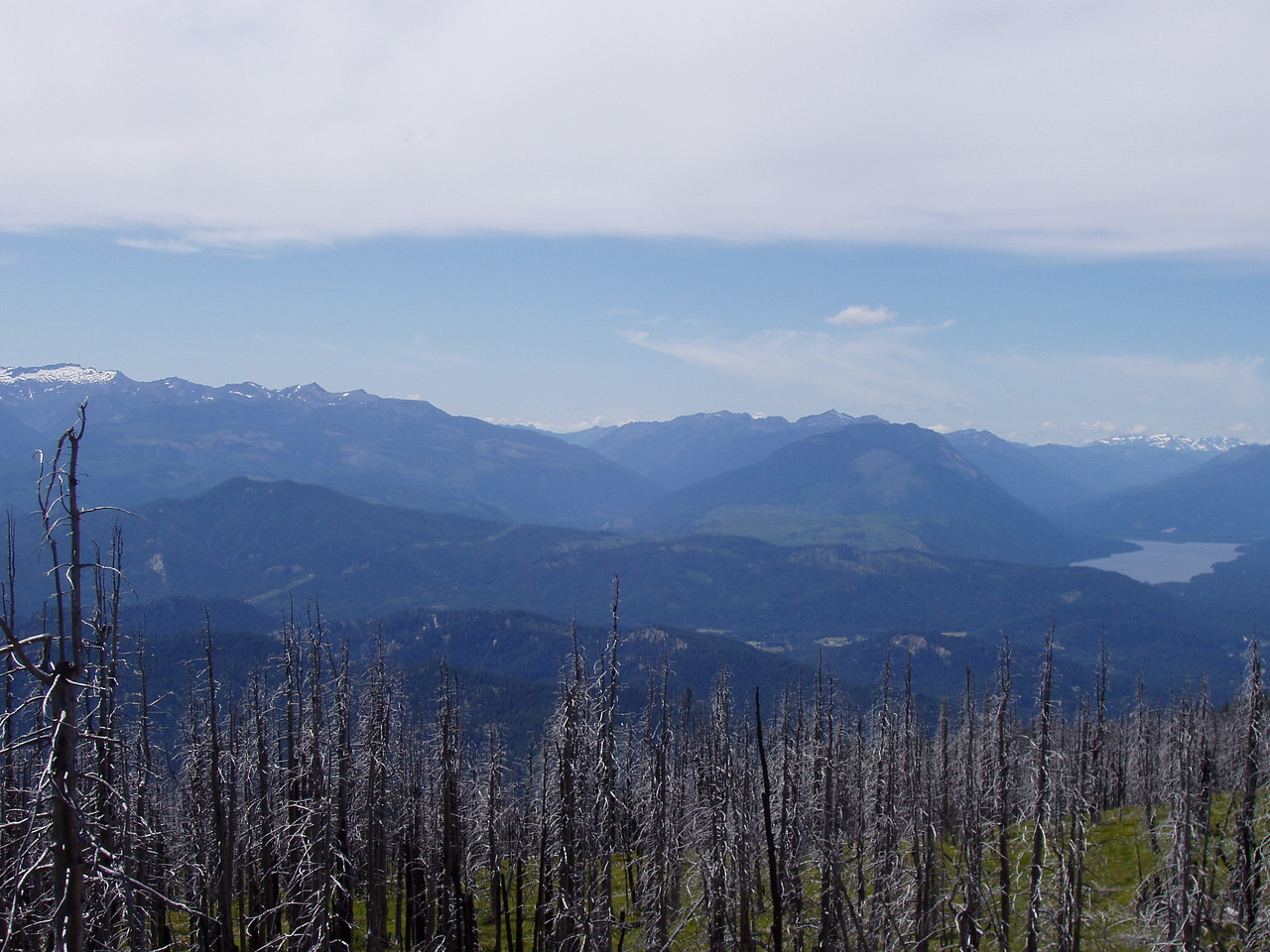 This is the central photo in the group of three.  Lake Wenatchee on the right edge.  Notice the burned trees in the foreground...