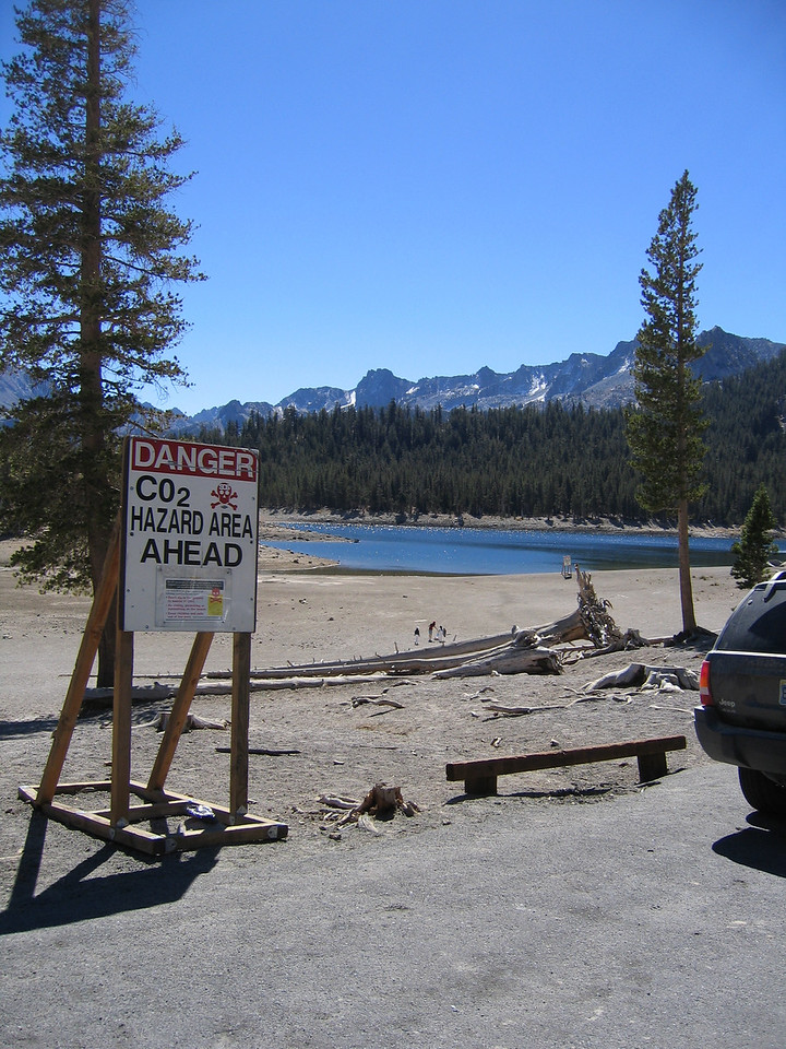 This lake is in the Mammoth Caldera and CO2 still off-gases near the beach.  As a result, no sitting or lying on the beach. No picnics except in the parking lot :)