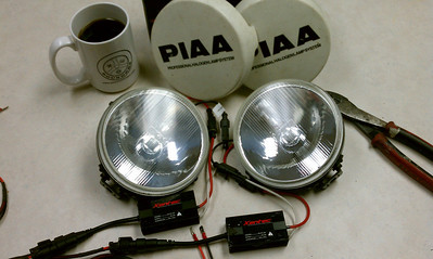 I decided to use my old PIAA 4062 driving lights on the bike, just for long trips but the 85 watt halogen bulbs would have to go. Auxiliary HID lights could cost hundreds of dollars. However, HID conversion kits are downright cheap. $35 on ebay.