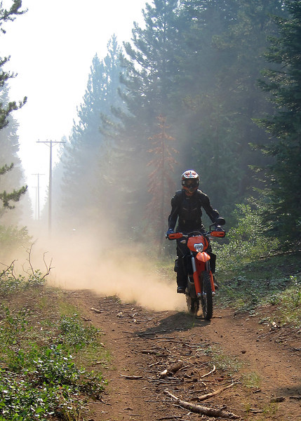 Jim trying to stay ahead of the dust on the powerline trail...