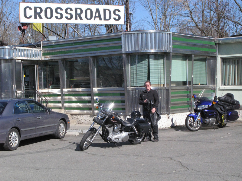 Breakfast at the crossroads.   I can count on them having scrapple, and its a good starting point for wherever you want to go.<br /> <br /> Immeadiatly after taking this photo, I was to discover that the wing's battery had self-discharged to the pont it would not crank the bike.