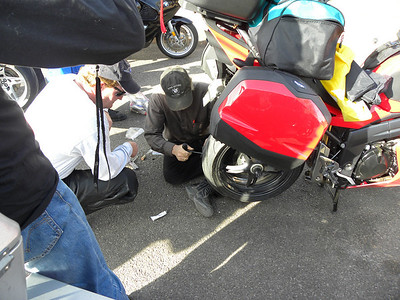At the Marathon Motel Paul Glaves fixing Lance's tire