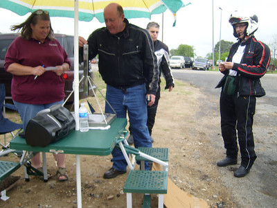 Checkpoint 4 in Industry TX.  Jeff dropping the metal nut that goes through the tube and hits the pyramid-shaped deflector and goes in one of the 4 directions.  Tina Smith is supervising while Howard and Ruby watch.