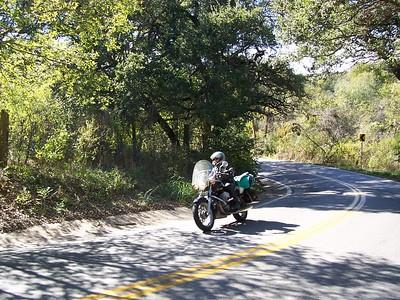 Caroline on a hairpin curve on Fitzhugh Road near Austin.