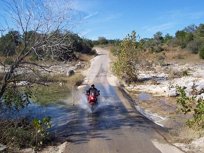 A water crossing we frequently splash through on hill country rides. Half the time it is dry, but not today!