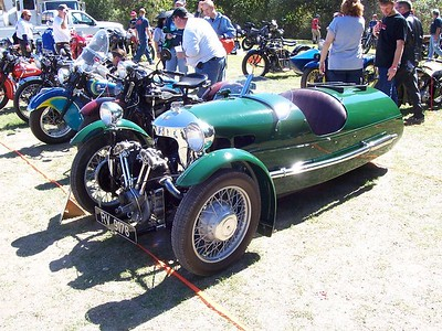 A Morgan. When the owner rode by later, it was neat to see the external valve train in operation.