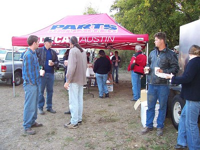 At the breakfast tent, rally founder, Russell Duke (in ballcap), is already plotting next year's rally.