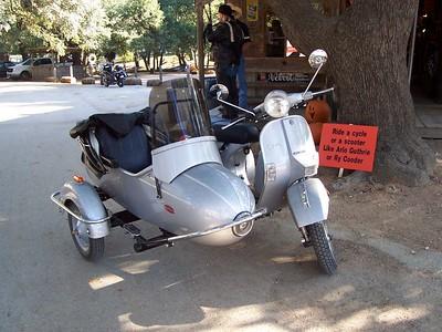 A Vespa scooter & sidecar.