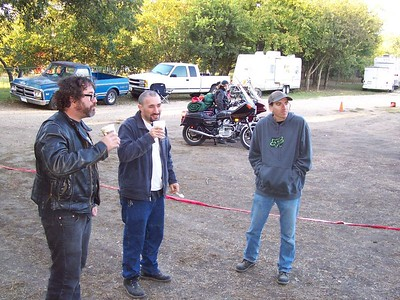 Back at Luckenbach: over camp coffee, Laurent (middle) discusses the finer points of Guzzi vs. Triumph restoration with another bike nut.